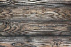 Un vecchio fondo marrone di legno di quattro bordi immagini stock