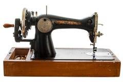 Un vecchio, macchina di cucitura a mano su fondo bianco Fotografia Stock