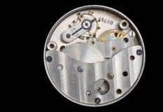 Un vecchio movimento a orologeria Immagine Stock