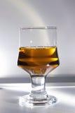 Un vetro del liquore della bacca della nuvola Fotografia Stock