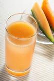 un vetro del succo del melone Immagini Stock Libere da Diritti