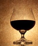 Un vetro di vino rosso Immagine Stock