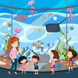 Un viaggio di scuola all'acquario illustrazione vettoriale