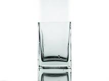 Un vidrio aislado en el fondo blanco Foto de archivo libre de regalías