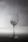 Un vidrio con agua Foto de archivo libre de regalías