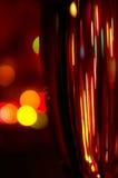 Un vidrio de champán en fondo de las luces Imagen de archivo