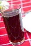 Un vidrio de cola Foto de archivo
