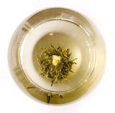 Un vidrio de té floreciente del artesano Fotografía de archivo libre de regalías