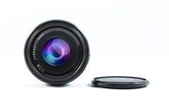 Un vieil objectif de caméra de contrôle manuel d'isolement sur le blanc Images libres de droits
