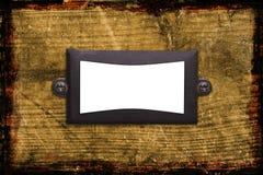 Un viejo marco textured del metal en el fondo de madera Imagen de archivo libre de regalías