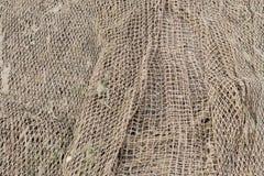 Un vieux filet de pêche dans un village de pêche Images stock