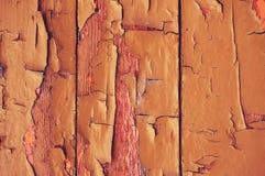 Un vieux fond en bois peint avec la peinture avec des fissures, des éraflures et la bande de frottement Photo stock