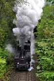 Un vieux train fonctionnant grand de vapeur images libres de droits