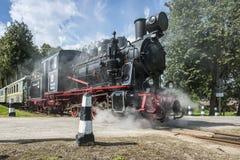 Un vieux train fonctionnant grand de vapeur Image stock