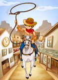Un villaggio con una giovane guida del ragazzo in un cavallo Immagini Stock