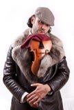 Un violinista joven con su violín Foto de archivo