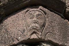 Un visage dans la pierre à l'abbaye d'Innisfallen sur l'île d'Innisfallen Photographie stock