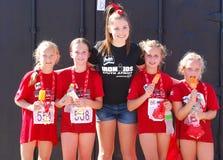 Petits athlètes heureux d'Ironkids Photo stock