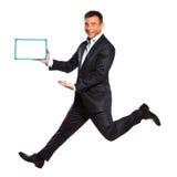 Un whiteboard di salto funzionante della holding dell'uomo Fotografie Stock Libere da Diritti
