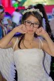 Una actitud no identificada del presentador en el festival GRANDE 2013 de la demostración de juego de Tailandia foto de archivo