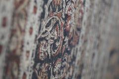 Una alfombra mágica por la pared fotografía de archivo
