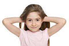 1c9da729a2e4 Vestito timido dalla bambina in rosso. Una bambina adorabile immagine stock