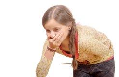 Una bambina ha un mal di stomaco Fotografie Stock