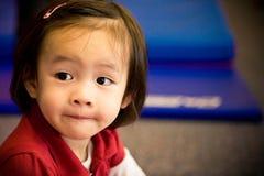 Una bambina nel colore rosso Fotografia Stock Libera da Diritti