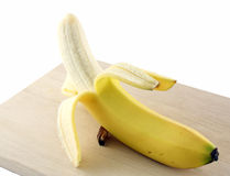 Una banana sbucciata Fotografia Stock Libera da Diritti