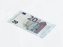 Una banconota degno l'euro 20 isolato su un fondo bianco Fotografie Stock Libere da Diritti