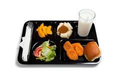 Una bandeja negra del almuerzo de escuela en un fondo blanco Foto de archivo libre de regalías