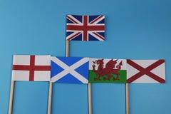 Una bandera oficial de Reino Unido y banderas de sus miembros Escocia, Inglaterra, País de Gales, Irlanda del Norte Imagen de archivo libre de regalías