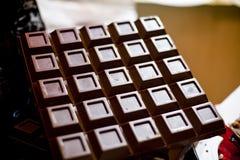 Una barra di cioccolato scuro Immagine Stock Libera da Diritti