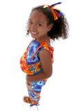 Una bella ragazza di sei anni che si leva in piedi sopra il bianco Immagine Stock Libera da Diritti
