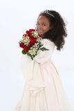 Una bella ragazza di sei anni con le rose rosse in convenzionale Immagini Stock