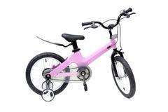 Una bicicleta para el ni?o en color rosado fotos de archivo libres de regalías