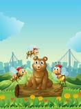 Una Big Bear sobre el registro con tres abejas stock de ilustración