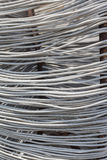 Una bobina del primo piano del filo di acciaio fotografia stock