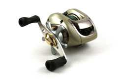 Una bobina dorata di Baitcasting pronta a andare pescare Fotografia Stock Libera da Diritti