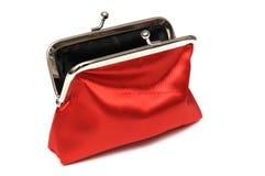 Una bolsa roja de la moneda de la señora con la abertura del botón a presión Fotografía de archivo libre de regalías