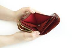 Una borsa vuota in sue mani Fotografia Stock