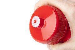 Una botella de agua roja Foto de archivo libre de regalías
