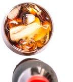 Una botella de bebida de la cola con el hielo II Imágenes de archivo libres de regalías