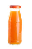 Una botella de jugo del melocotón Imagen de archivo libre de regalías