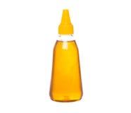 Una botella de la miel natural I fotos de archivo libres de regalías