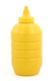 Una botella de mostaza amarilla Imagen de archivo libre de regalías