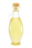 Una bottiglia dell'olio di oliva su priorità bassa bianca immagini stock libere da diritti