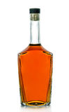 Una bottiglia di brandy su un fondo bianco Fotografia Stock