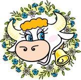 Una buena vaca en flores Foto de archivo libre de regalías