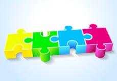 Una bugia rossa verde blu gialla di quattro puzzle su un bianco Fotografia Stock Libera da Diritti
